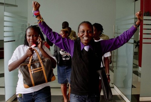 Gay rights activists react as the constitutional court overturns anti-gay laws in Uganda. Credit Isaac Kasamani/Agence France-Presse — Getty Images.